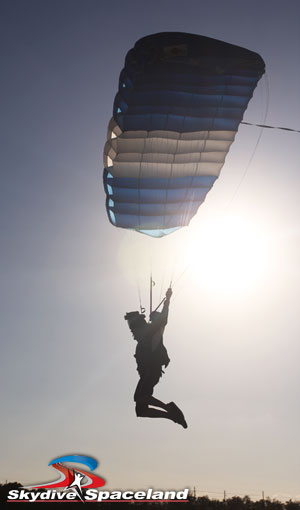 Skydiver flying a parachute